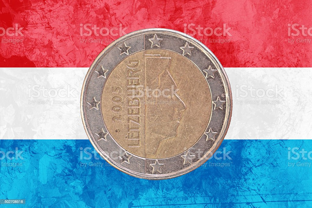 Luxembourgish two euros coin with flag of Luxembourg as background stock photo