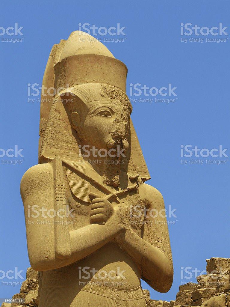 Luxor: giant statue of Pharaoh Ramses II. Karnak (antique Thebes) royalty-free stock photo