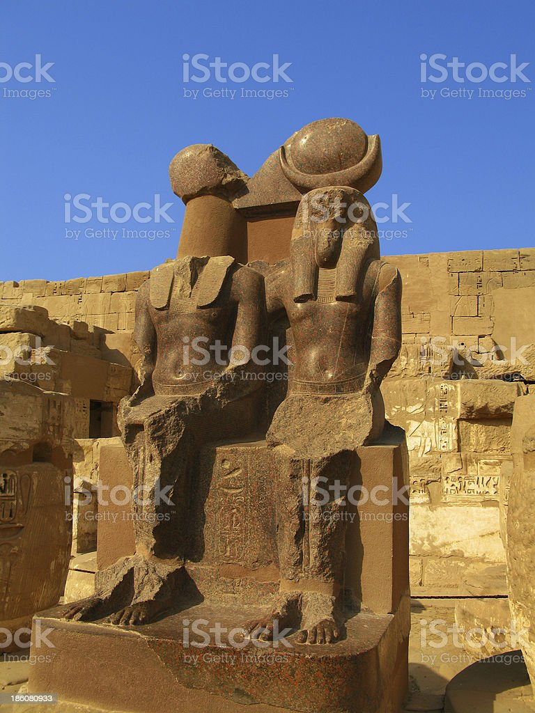 Luxor: Polished granite statue at the temple of Medinet Habu stock photo