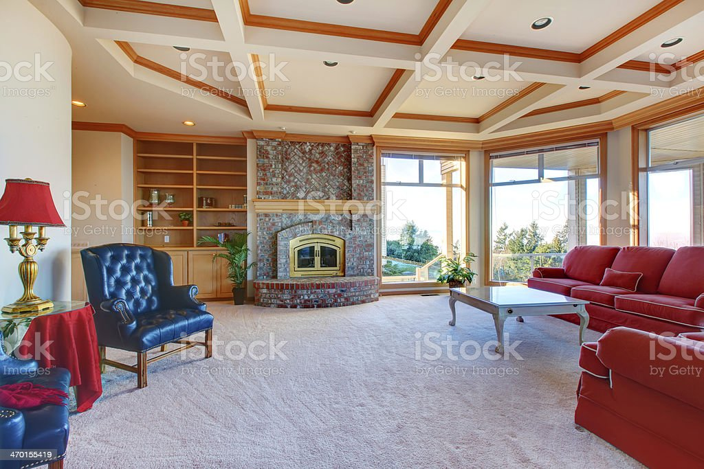 Luxuriant family room with fireplace and elegant furniture stock photo