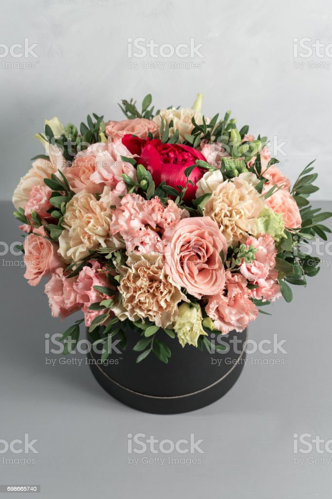 luxurious and elegant bouquet of roses and Other colors flowers on wooden background, copy space. stock photo