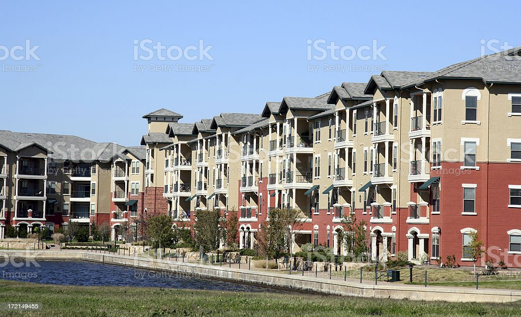 Luxurious Apartment Complex Overlooking A Pond stock photo