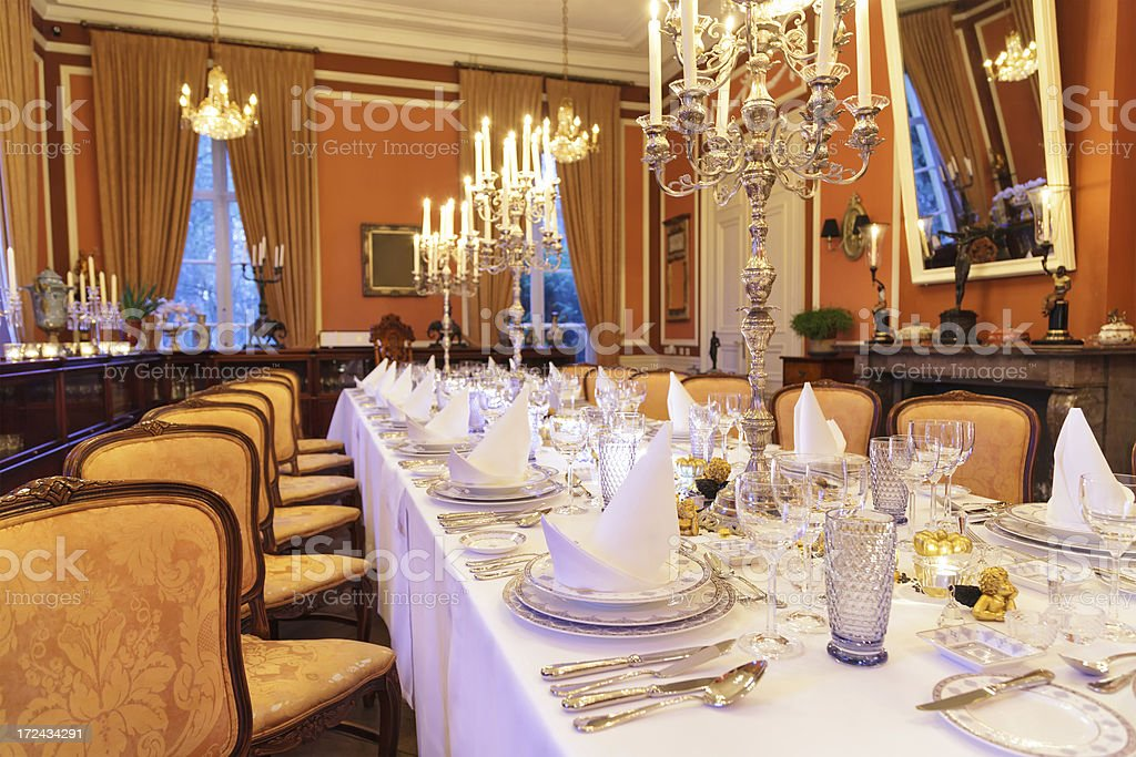Luxurious banquet room decorated with chandeliers in a mansion stock photo