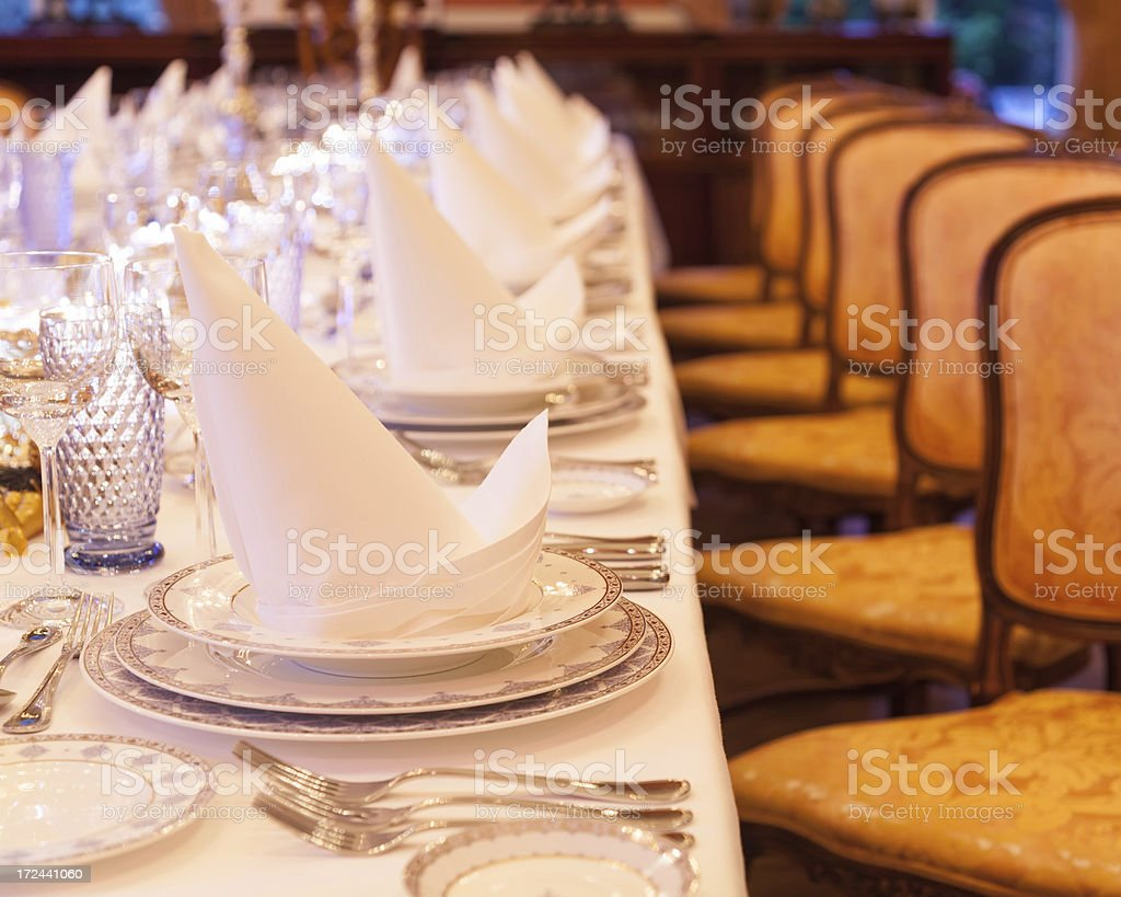 Luxurious banquet table in a mansion royalty-free stock photo
