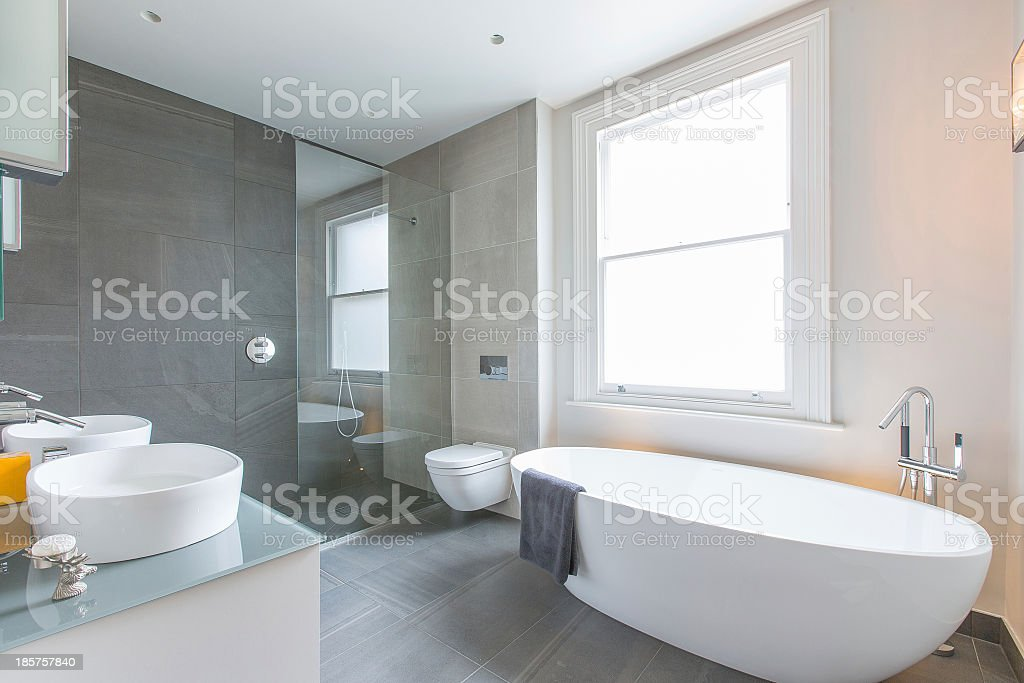 Luxurious bathroom with porcelain tub and sink stock photo