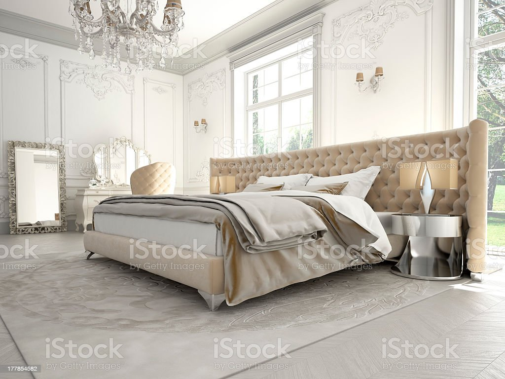Luxurious bedroom featuring chandelier, hotel style bedding stock photo