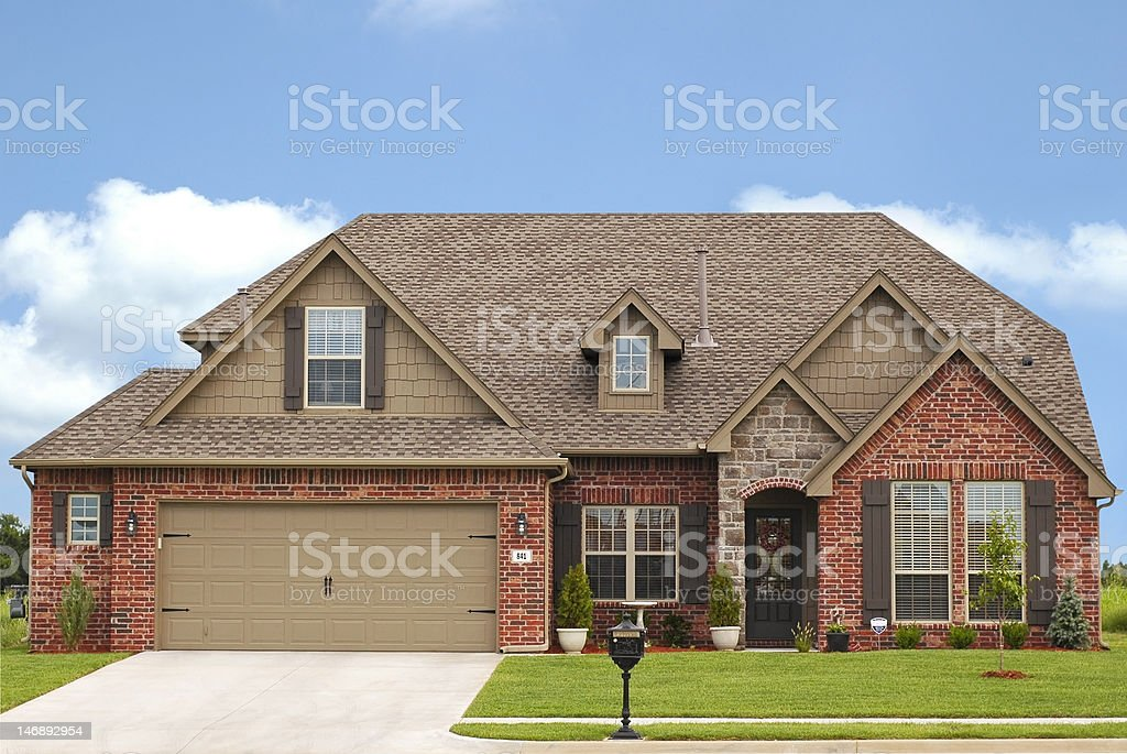 Luxurious brick home in expensive neighborhood stock photo