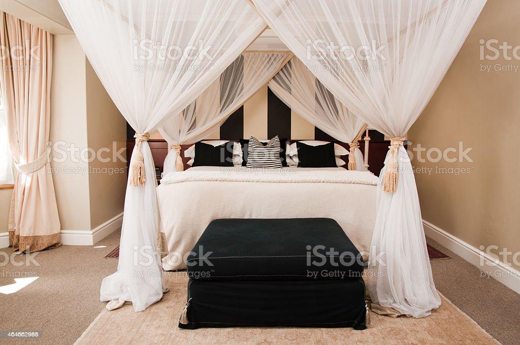 luxurious canopy bedroom stock photo