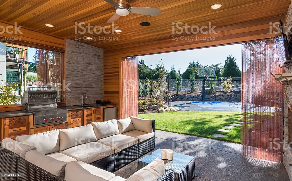 luxurious covered patio with barbecue and sink stock photo