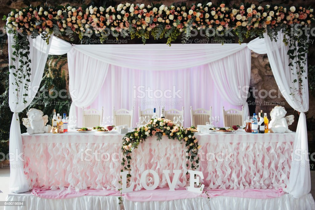 luxurious decorated table in the main hall wedding stock photo