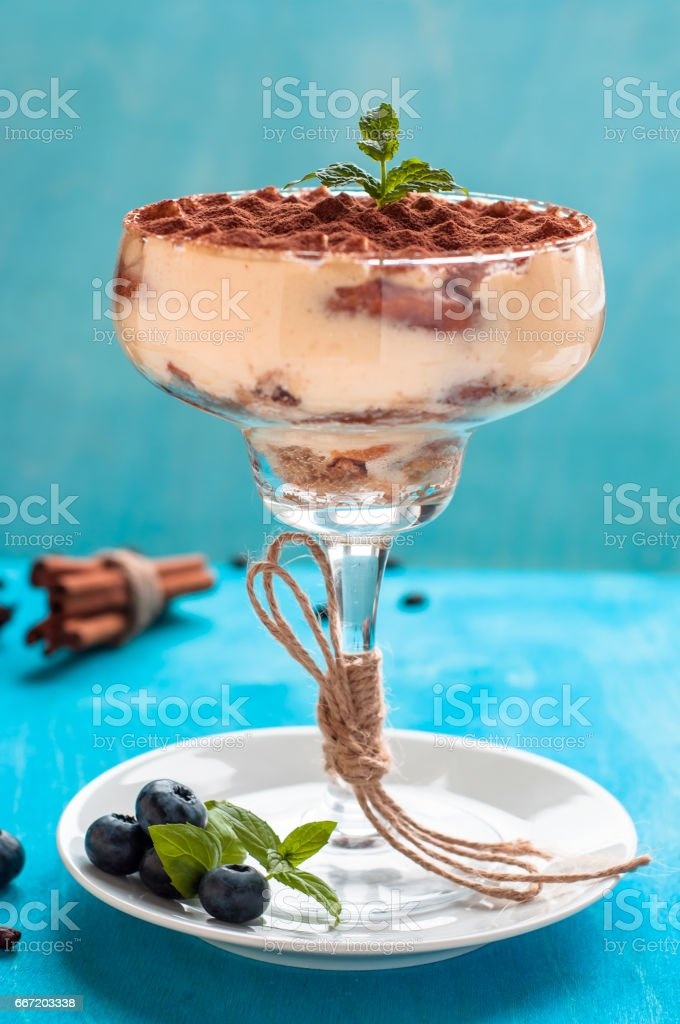 luxurious dessert Tiramisu in a glass decorated with mint stock photo