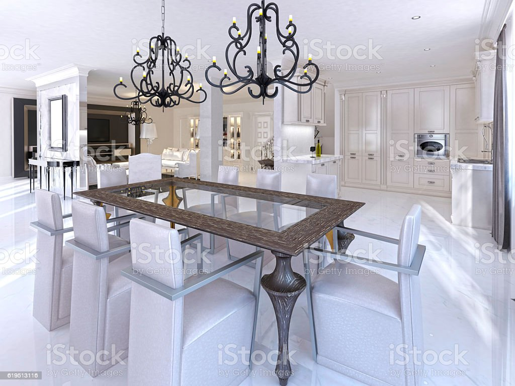 Luxurious dining room with dining table and designer chairs. stock photo