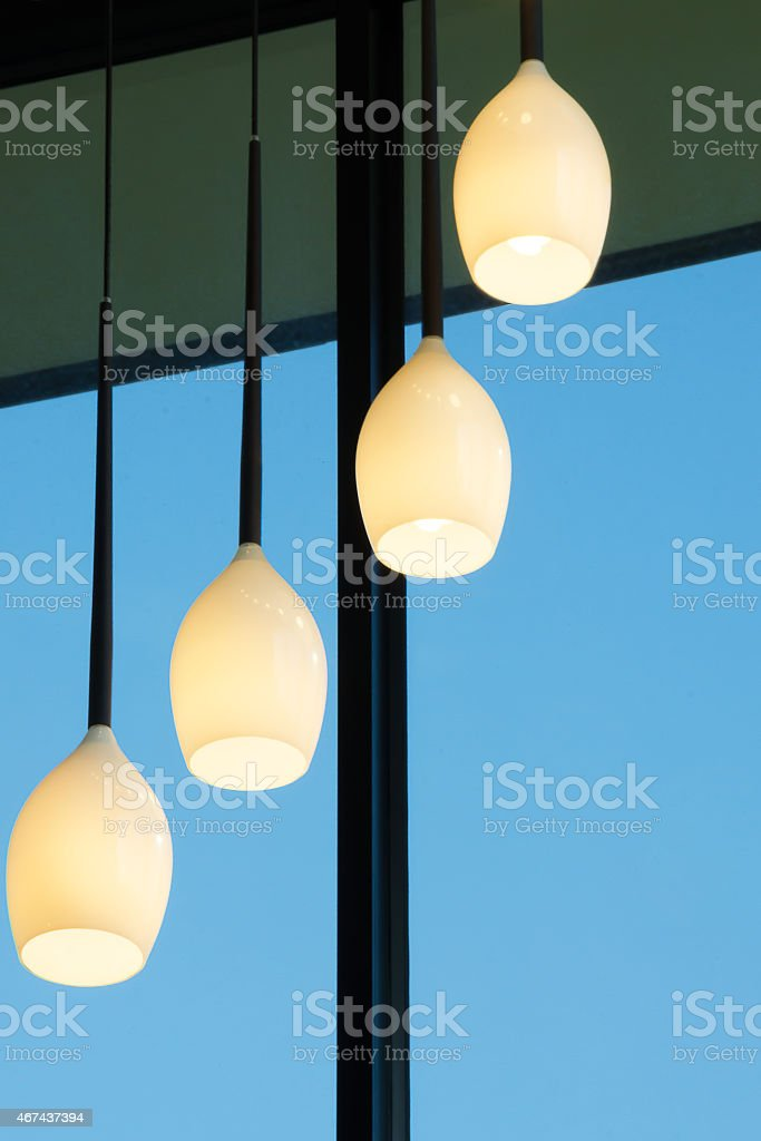 Luxurious entry to a modern upscale chandeliers. stock photo