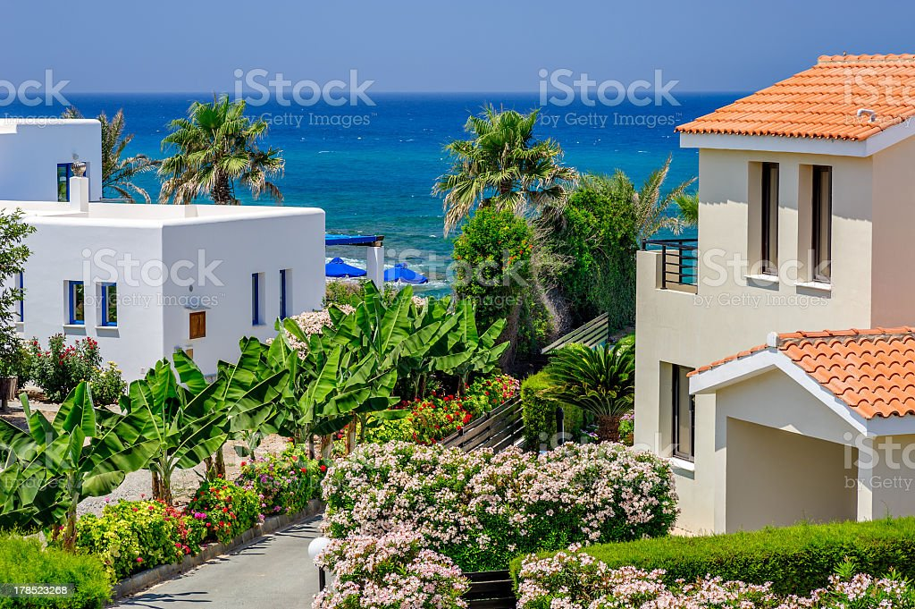 Luxurious holiday beach villas in resort stock photo