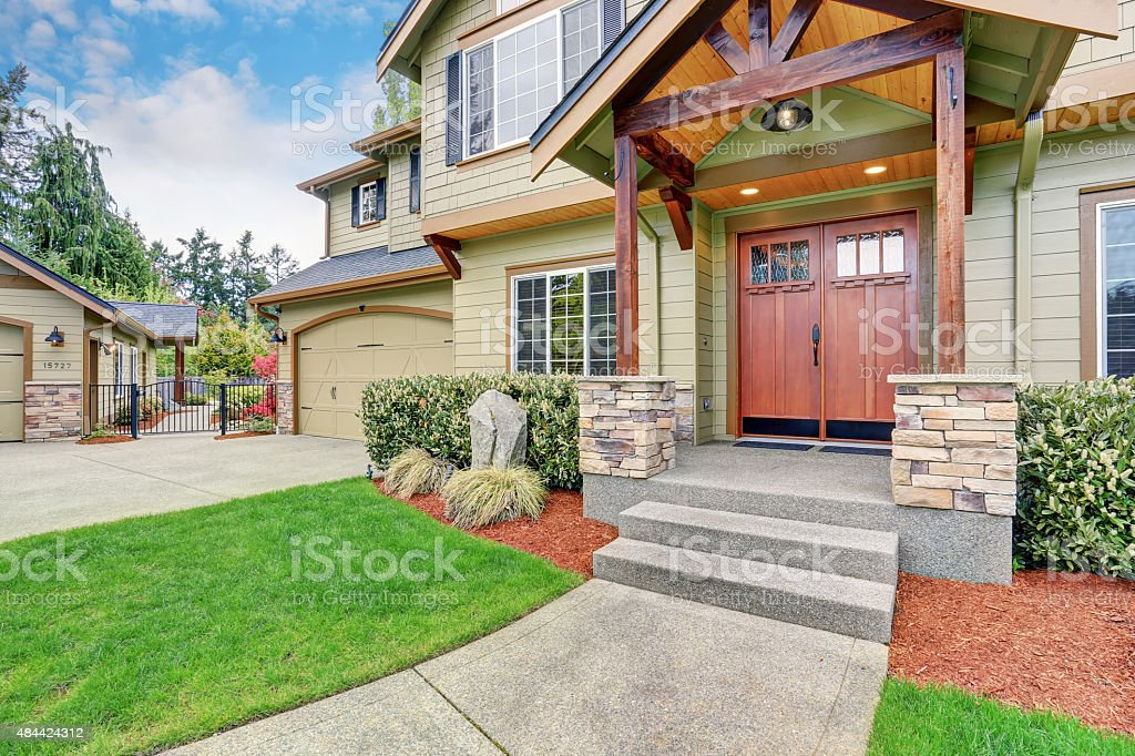 Luxurious home with large driveway. stock photo