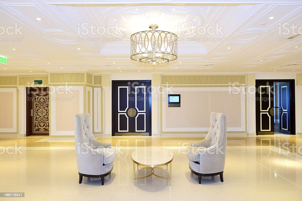 Luxurious hotel lobby at night with partial symmetry stock photo