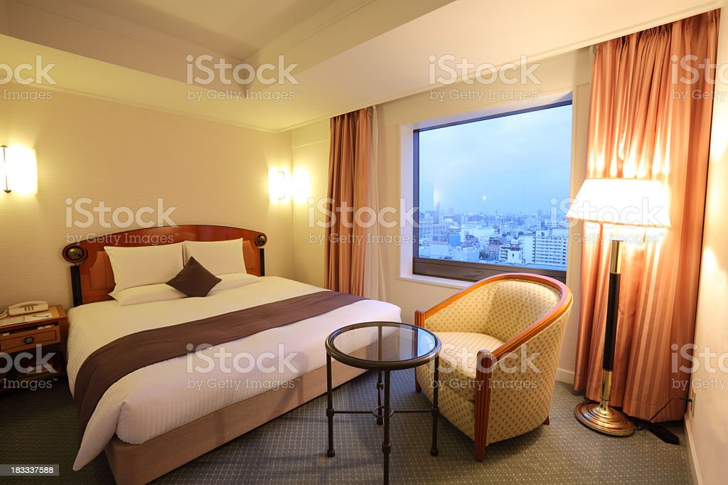 Luxurious hotel room with an amazing skyline view  royalty-free stock photo