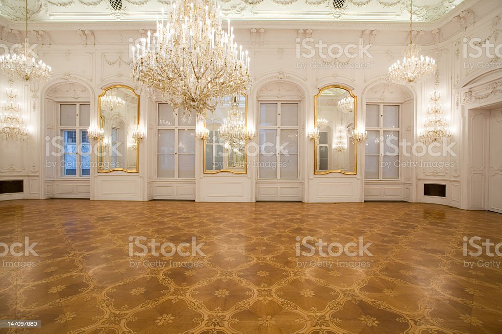 A luxurious interior of a castle with huge chandelier  stock photo
