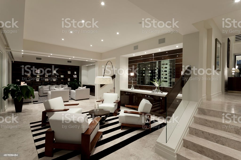 Luxurious livng room with two areas stock photo