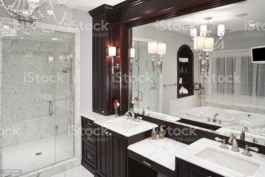 Luxurious marble master bathroom with jacuzzi tub. stock photo