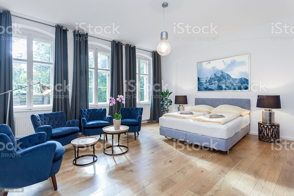 Luxurious Modern Bedroom with Sitting Area and King Bed stock photo