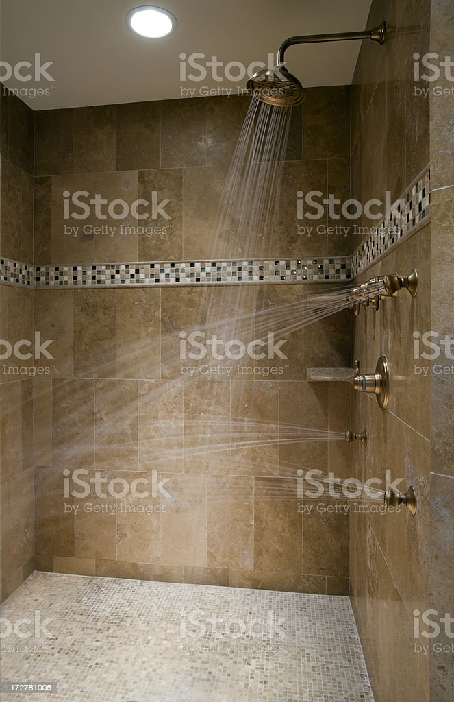 Luxurious running shower. stock photo