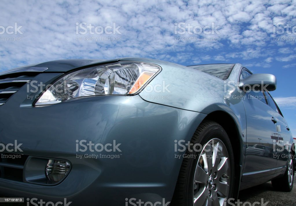 Luxurious Silver Sportscar With View Of Cloudscape royalty-free stock photo