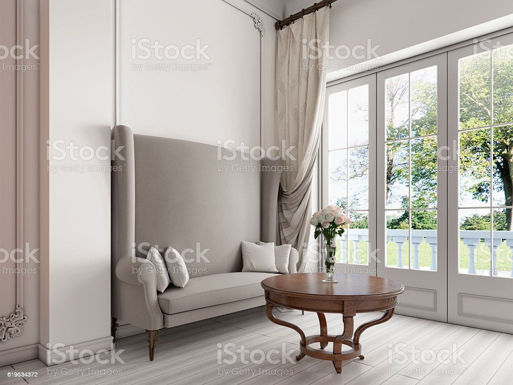 Luxurious sofa by the large panoramic Windows stock photo