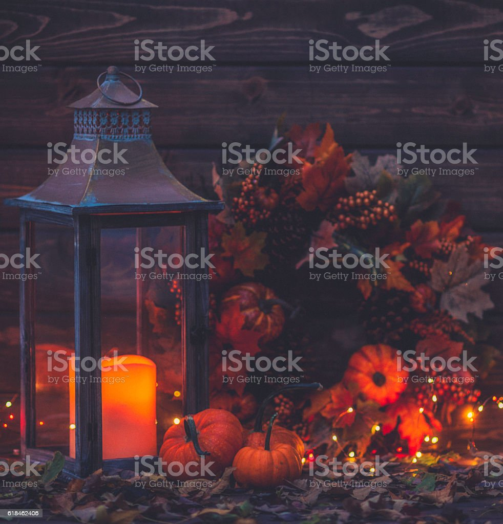 Luxurious still life arrangement for Thanksgiving with lantern and wreath stock photo