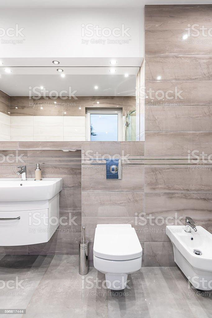 Luxurious travertine bathroom idea stock photo
