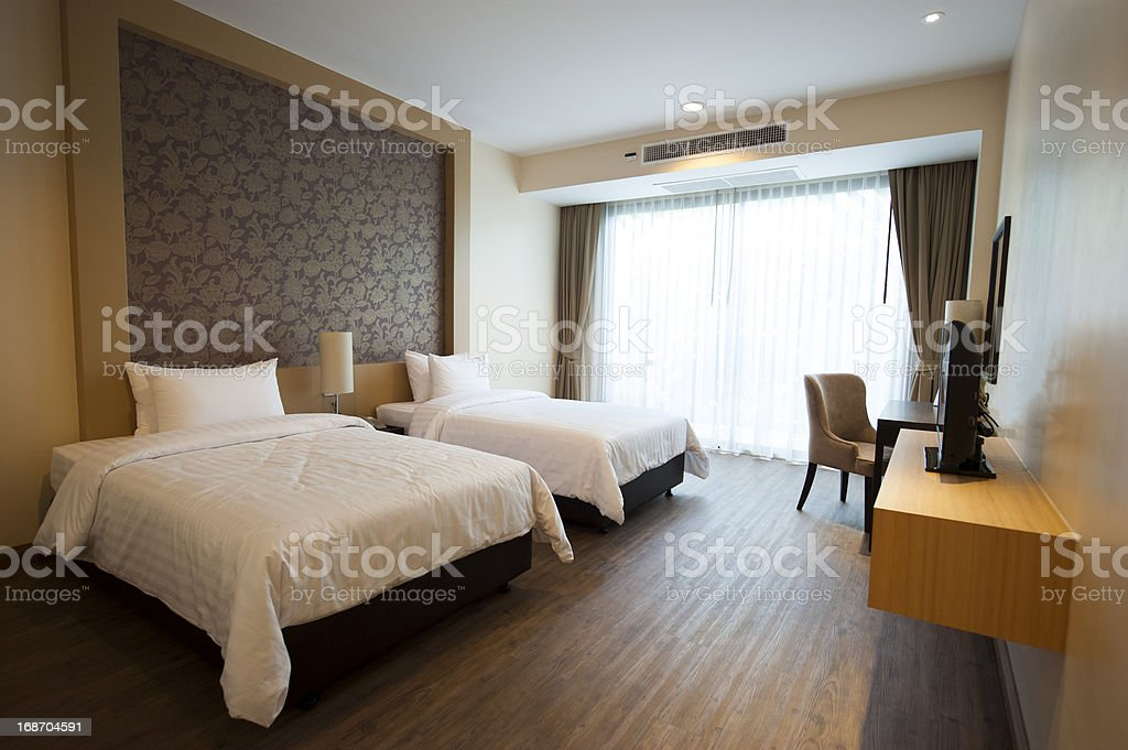 Luxurious two bed hotel room with hardwood floors stock photo