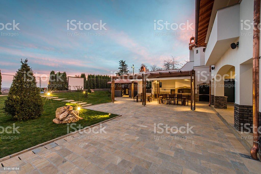 Luxurious villa exterior and magic sky stock photo