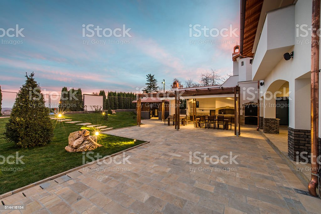 Luxurious villa exterior and magic sky stock photo