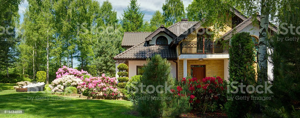 Luxurious villa with secluded garden stock photo