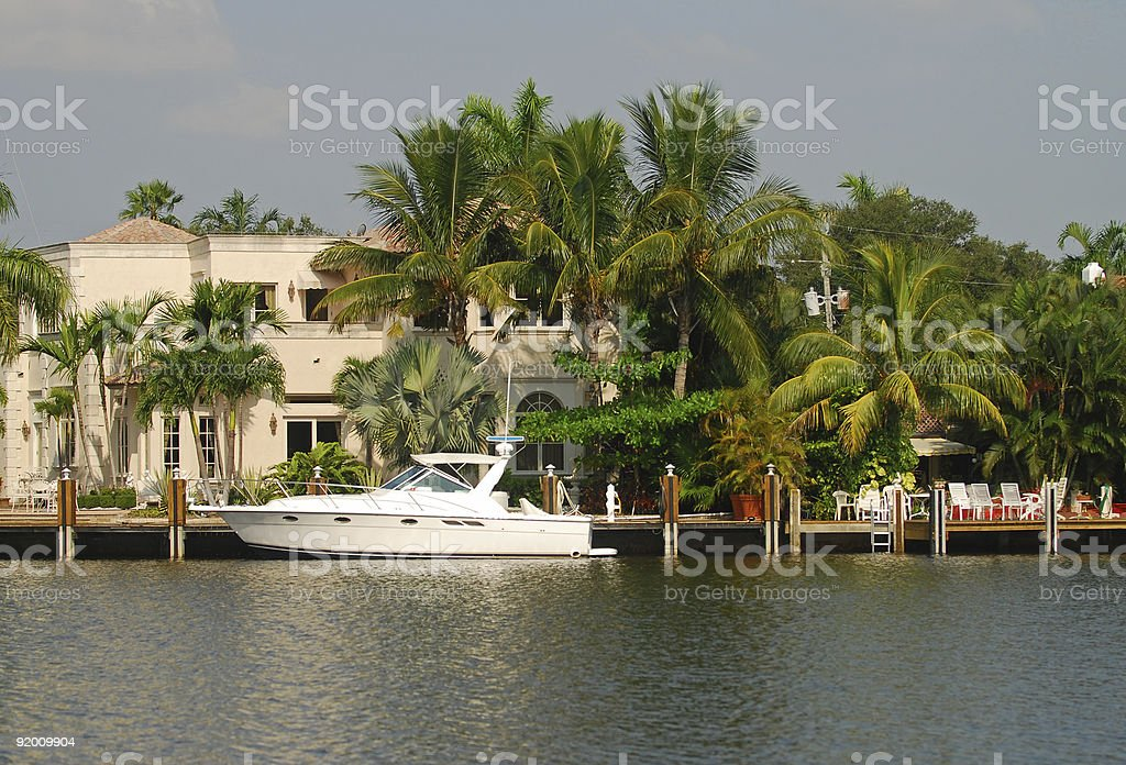 Luxurious waterfront home with dock royalty-free stock photo