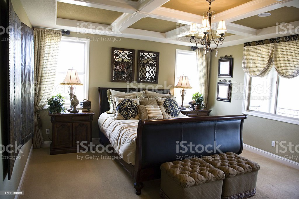 Luxury and cozy master bedroom. royalty-free stock photo