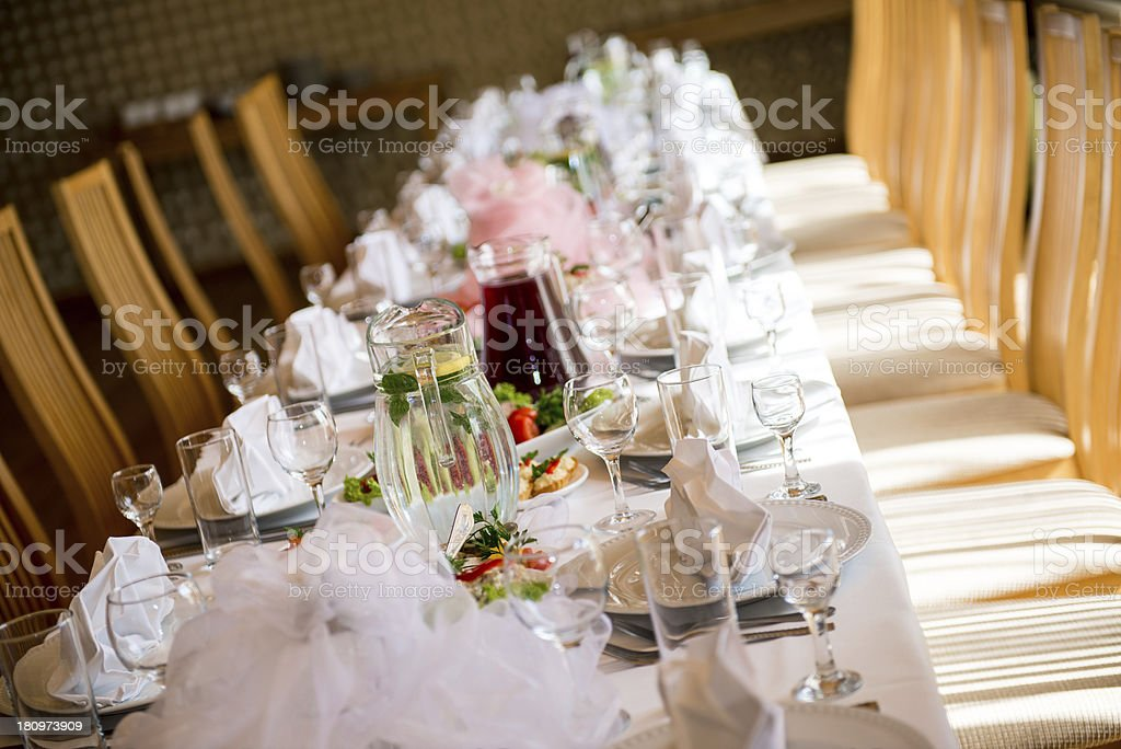 Luxury banquet table setting at restaurant royalty-free stock photo