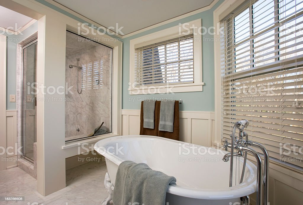 Luxury Bathroom Remodel Showing Bathtub and Shower. stock photo