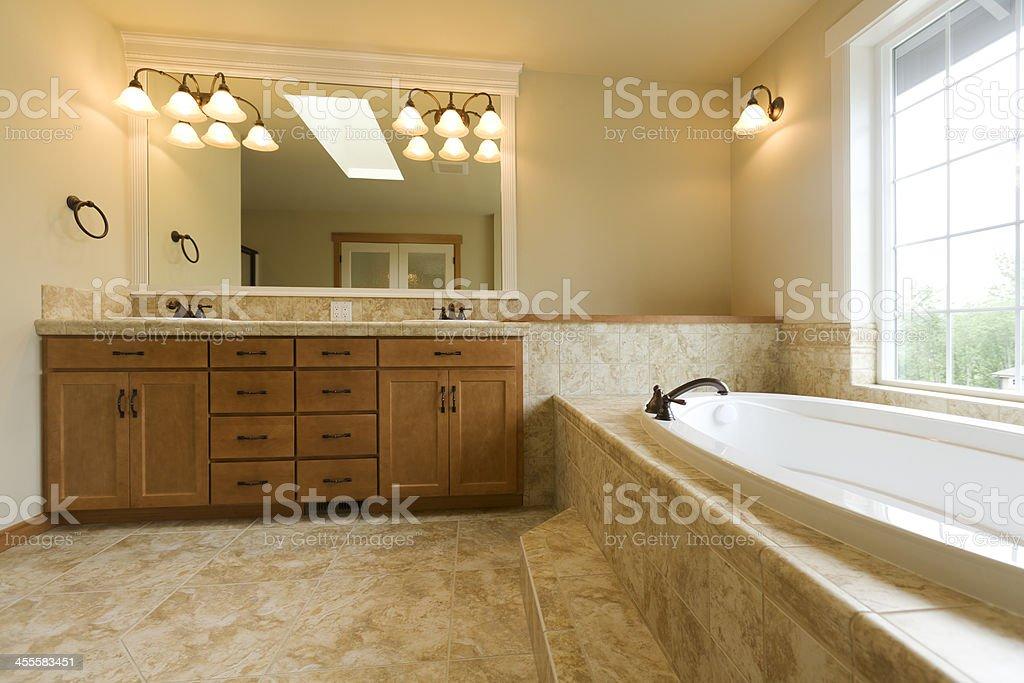 Luxury bathroom with travertine floors stock photo