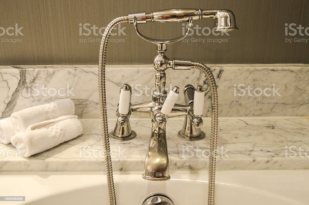 Luxury bathtub faucet stock photo