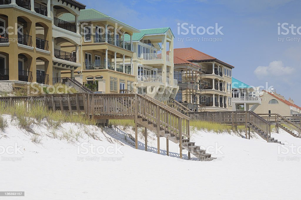 A photograph of beautiful, luxury beach houses sitting on the sugar...