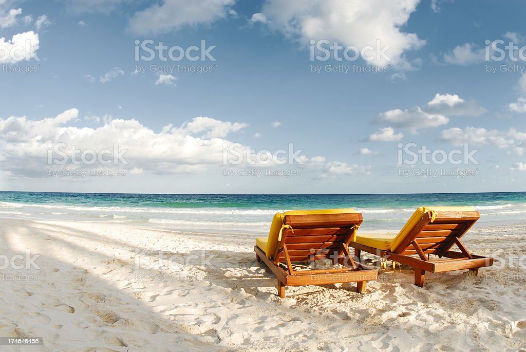 Luxury beach with white sand and blue water stock photo