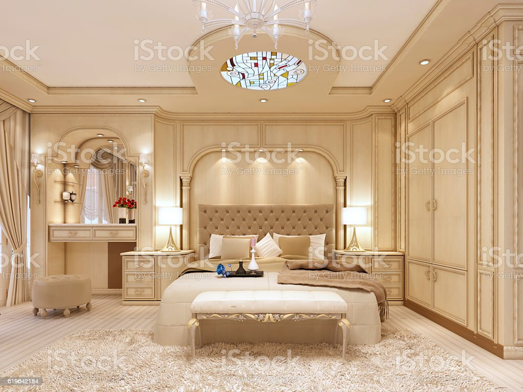 Luxury bed in a large neoclassical bedroom with decorative niche stock photo