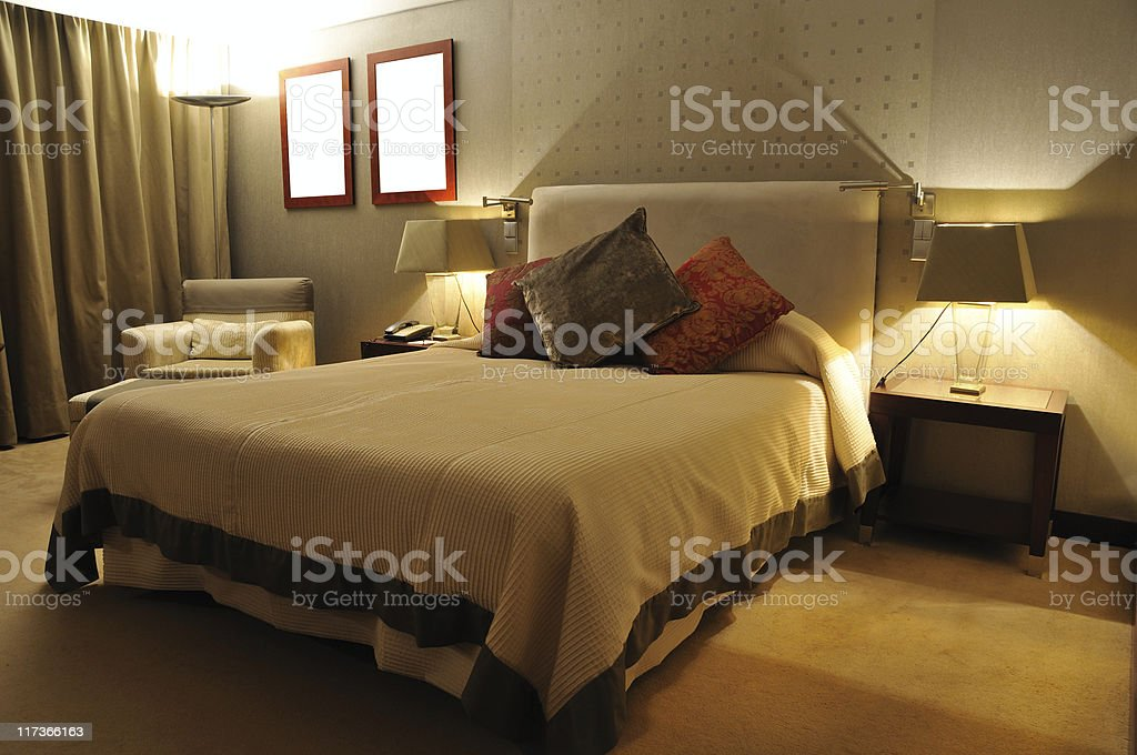 Luxury bedroom with big bed and lots of pillows royalty-free stock photo
