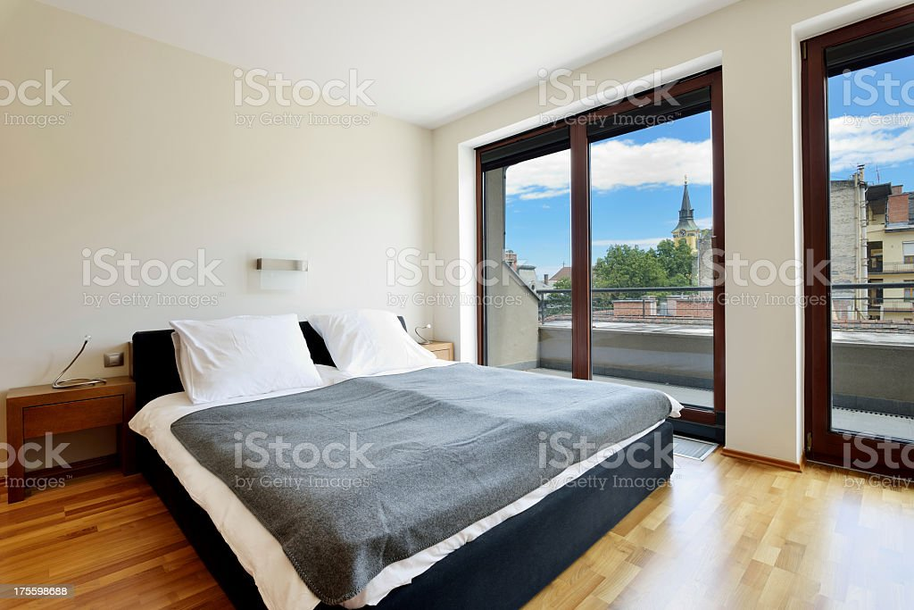 Luxury bedroom with city view stock photo