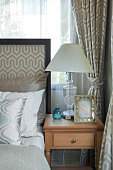 luxury bedroom with decorative table lamp.