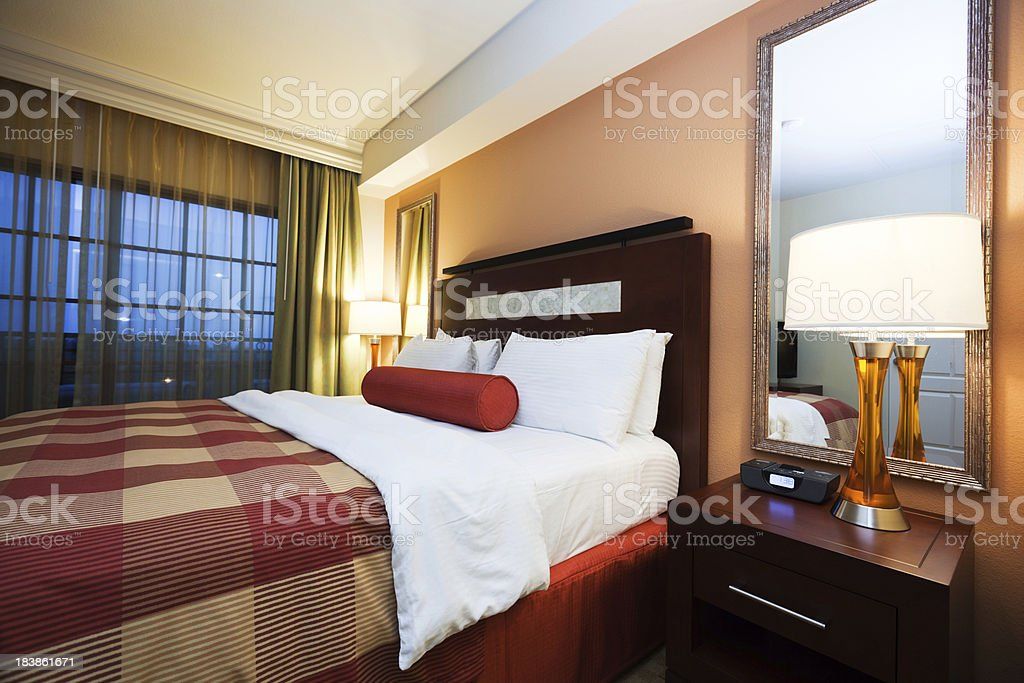 Luxury bedroom with king size bed and adjoining balcony royalty-free stock photo