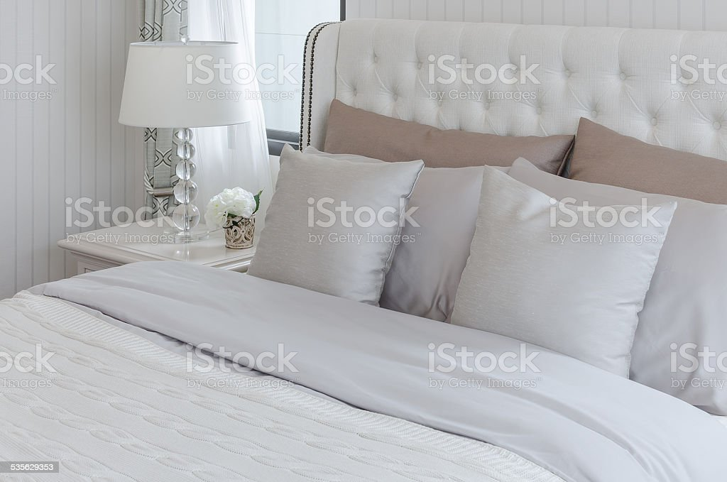 luxury bedroom with lamp on table stock photo