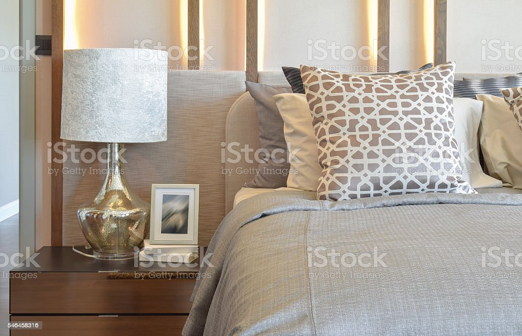 luxury bedroom with white lamp and picture frame on table stock photo