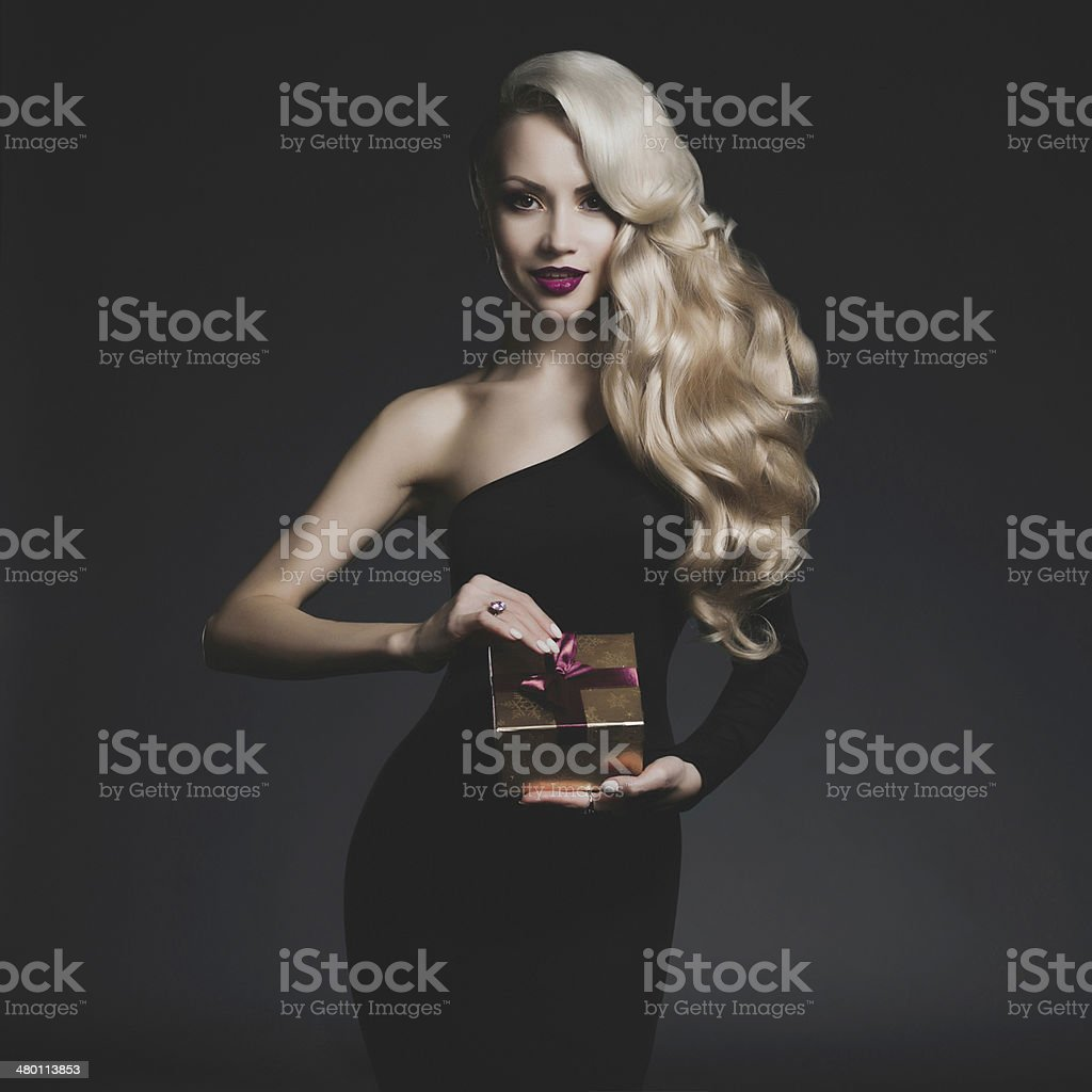 Luxury blonde with gift stock photo